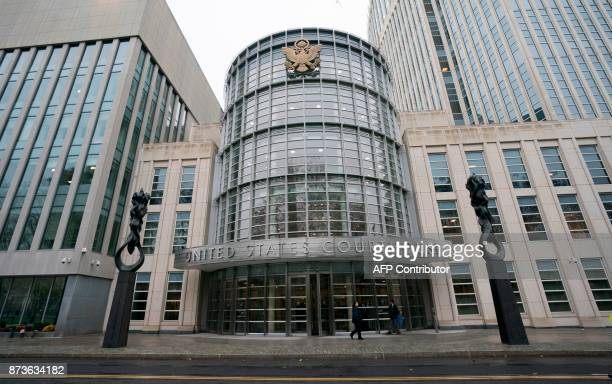 People wak past the Federal Courthouse in Brooklyn where the FFA trial is talking place on November 13 2017 in New York The FIFA corruption trial is...