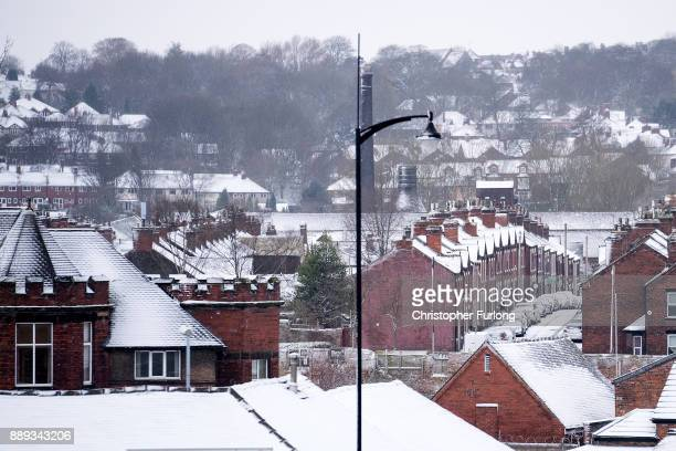 People wake up to a blanket of overnight snowfall on December 10 in Stoke On Trent United Kingdom Heavy snow has hit many parts of the UK closing...