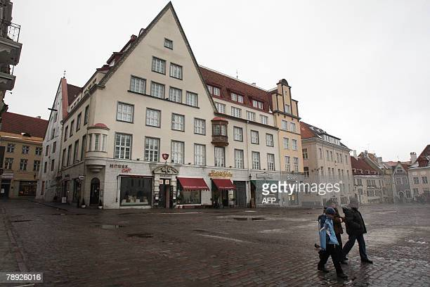 People walk 10 January 2008 in front of one of the most expensive houses in Tallinn that was returned to its preWorld War II owners Thousands of...