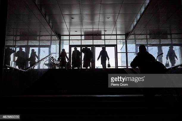 People walk a tunnel under the railway station during a power outage on February 8 2015 in Donetsk Ukraine The area is today constantly under fire of...