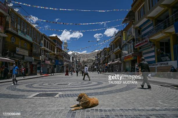 People walk across a square at a market in Leh, the joint capital of the union territory of Ladakh, on June 27, 2020.