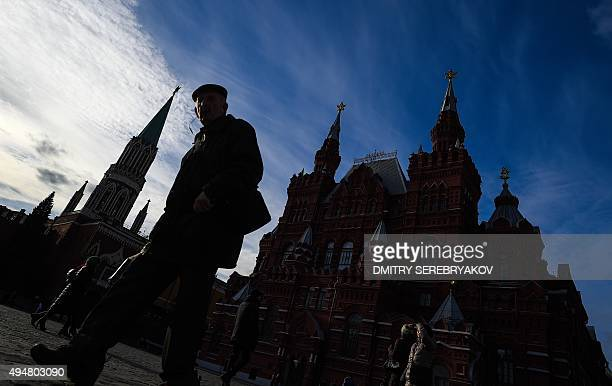 People walk across Red Square in central Moscow on October 29 2015 AFP PHOTO / DMITRY SEREBRYAKOV
