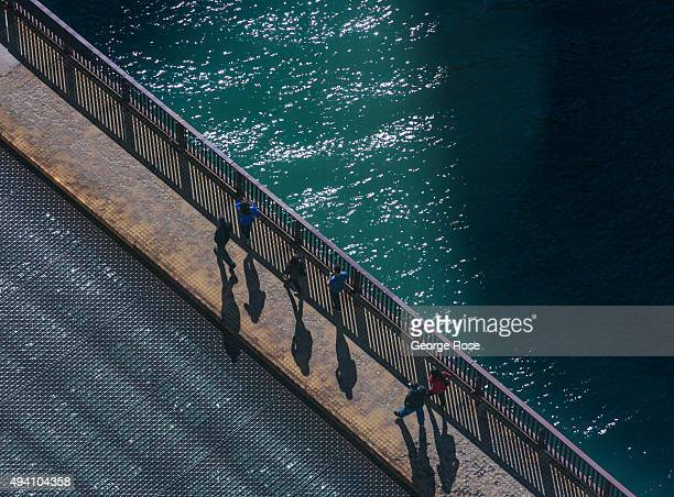 People walk across the Chicago River along the Columbus Avenue bridge on October 9 2015 in Chicago Illinois Chicago the third largest city in the...