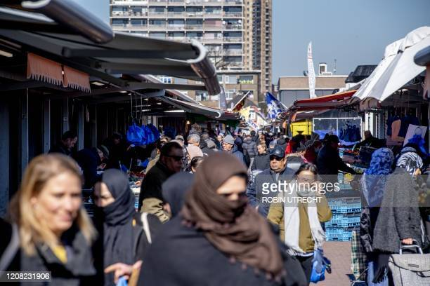 People walk across the Haagse Markt the daily market in the Hague on March 25 2020 The municipality has closed the market immediately because of the...