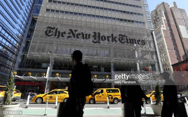 People walk along 8th Avenue in front of the New York Times headquarters on March 9, 2020 in New York City.