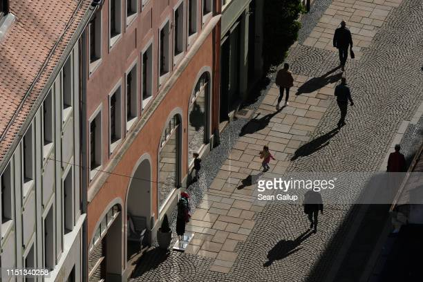 People walk along a pedestrian street in the historic city center on May 23 2019 in Goerlitz Germany Voters in Goerlitz will head to the polls on...