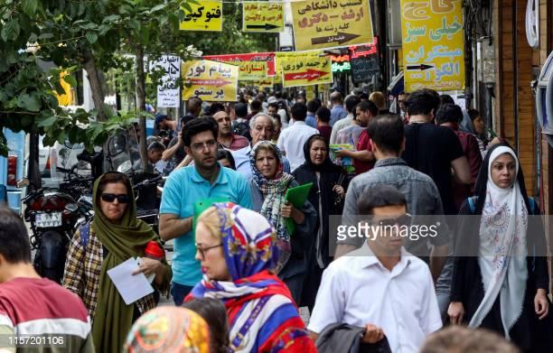 People walk along a street in the Iranian capital Tehran on July 22 2019