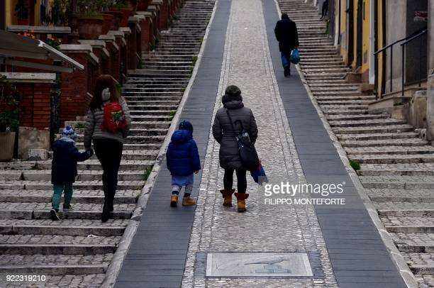 People walk along a street in the Italian town of Guidonia on February 1 2018 e In the industrial town of Guidonia near Rome its first Five Star...