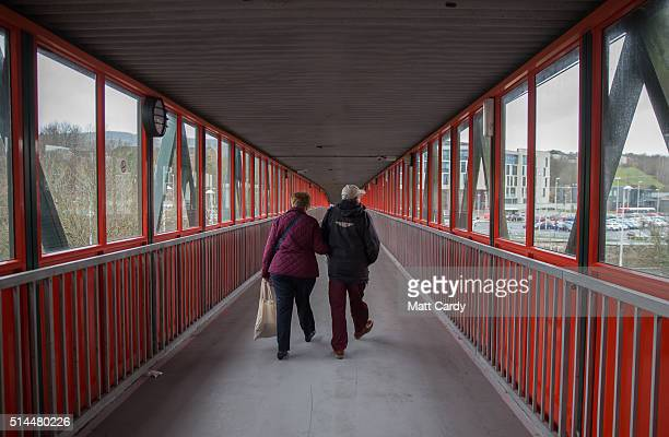 People walk along a walkway linking the main shopping centre to a car park on March 8 2016 in Merthyr Tydfil Wales The West Wales and the Valleys...