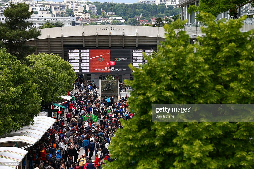People walk along Allee Marcel-Bernard backdropped by Court Suzanne Lenglen during previews ahead of the French Open at Roland Garros on May 24, 2014 in Paris, France.