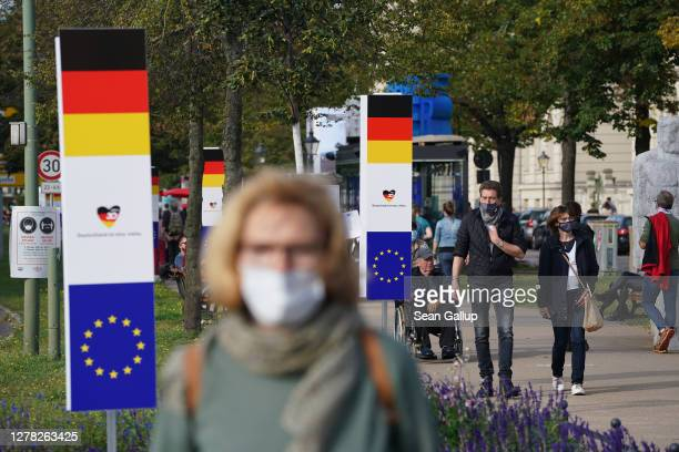 People walk along an outdoor installation on the 30th anniversary of German reunification on October 03, 2020 in Potsdam, Germany. On October 3...