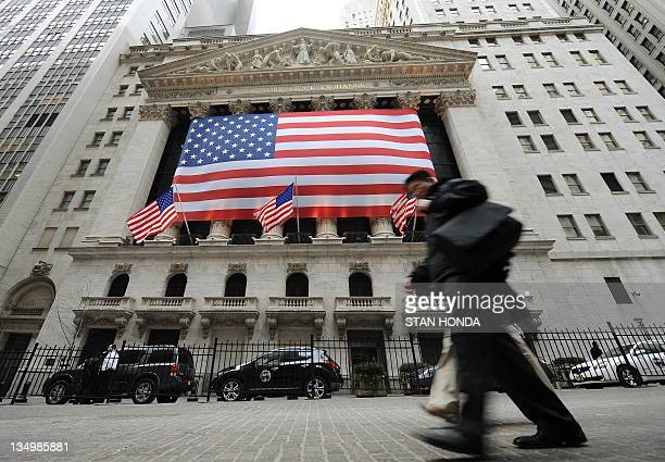 People walk along Broad Street February 10 2009 outside the New York Stock Exchange US stocks plunged Tuesday as markets gave a thumbs down to a plan...