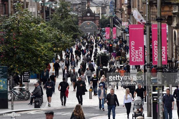 People walk along Buchanan Street in Glasgow City Centre on September 14, 2020. - Coronavirus rules were tightened Monday, with England and Scotland...