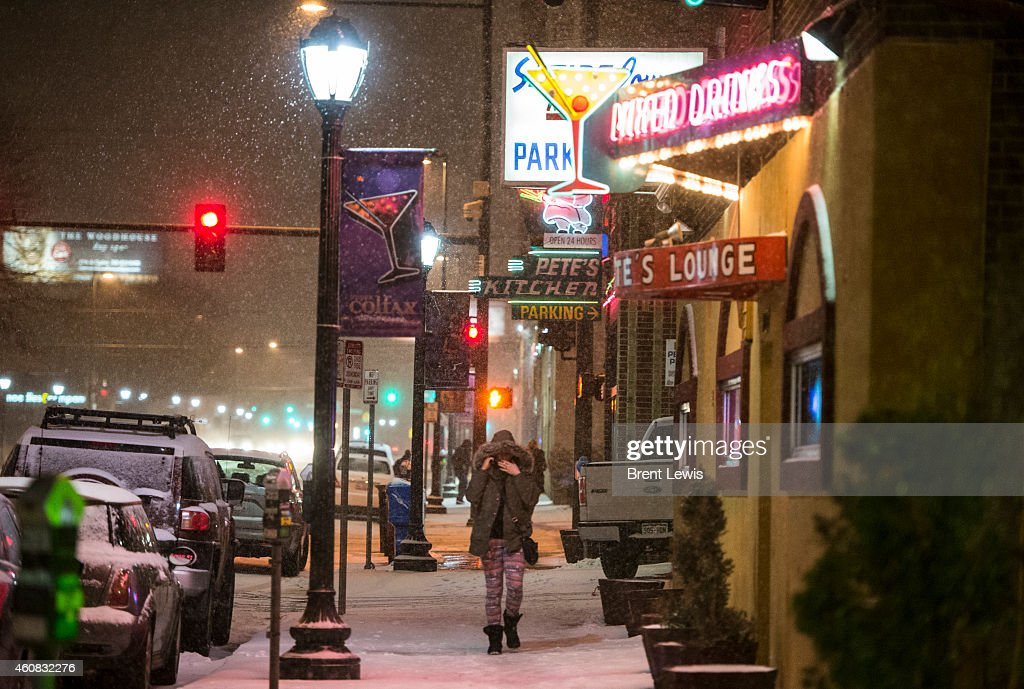 People Walk Along Colfax Ave Past Open Bars And Restaurants