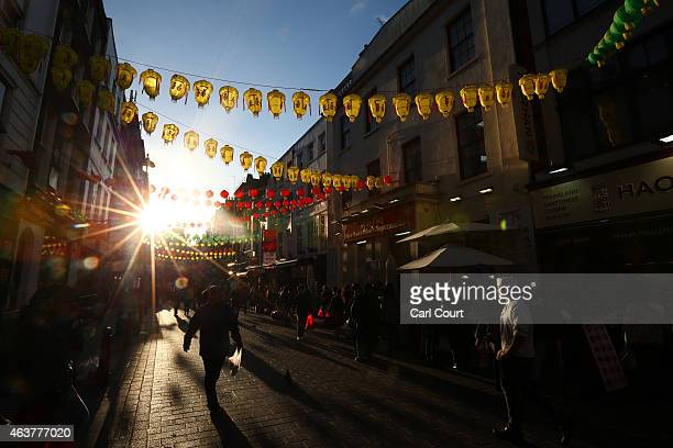 People walk along Gerrard Street in China Town on February 18 2015 in London England Chinese New Year 2015 the Year of the Sheep will be celebrated...