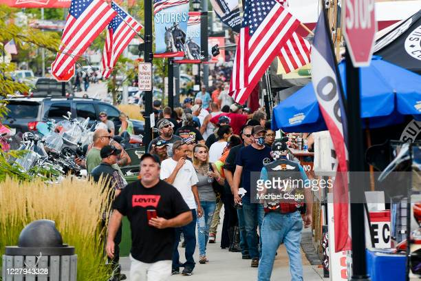 People walk along Main Street a day before the start of the Sturgis Motorcycle Rally on August 6 2020 in Sturgis South Dakota While the rally usually...