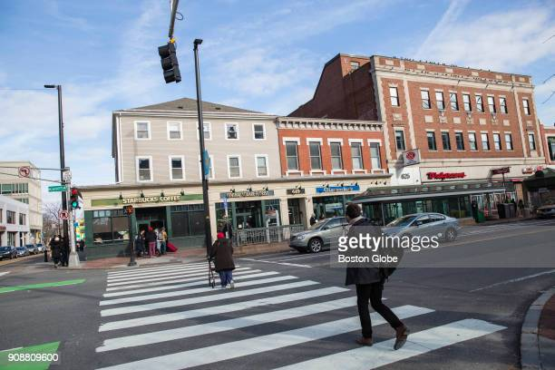 People walk along Massachusetts Avenue in Central Square in the Cambridgeport neighborhood of Cambridge, MA on Jan. 14, 2018.