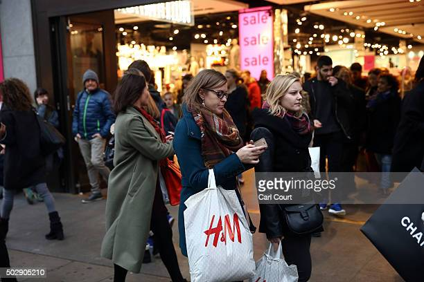 People walk along Oxford Street on December 30 2015 in London England Shoppers are continuing to spend as stores offer bargains in the run up to the...