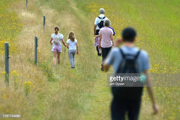 People walk along public pathway past Chequers house, the official country residence of the British Prime Minister, on August 04, 2020 in...