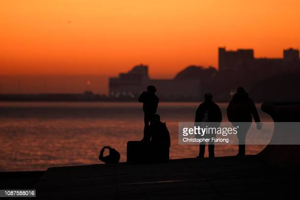 People walk along Samphire Hoe at sunset one of the remote Kent beaches where migrants have landed in the UK on December 28 2018 in Dover England The...