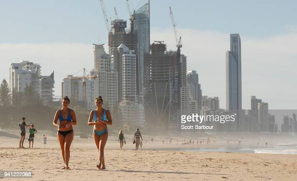 People walk along the beach ahead of the 2018 Commonwealth Games on April 3 2018 in the Gold Coast Australia