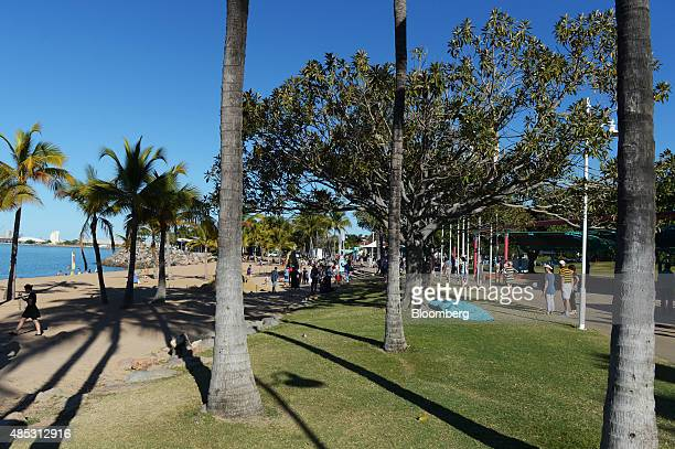 People walk along the beachfront promenade at the Strand in Townsville Queensland Australia on Saturday Aug 8 2015 Townsville is the largest general...