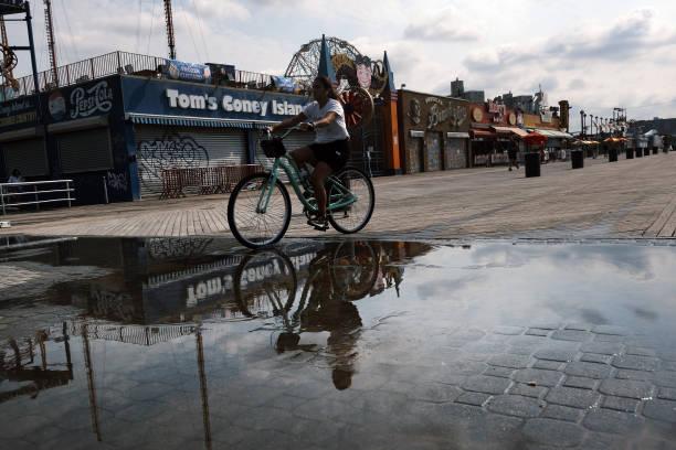 NY: New Yorkers Enjoy The Summer Heat On Coney Island