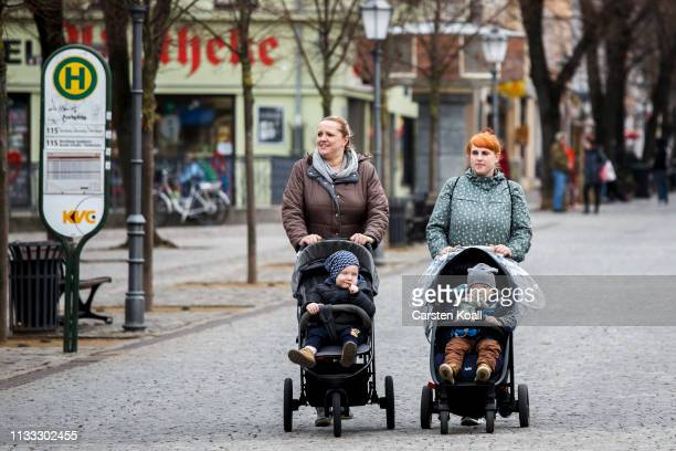 People walk along the central pedestrian shopping street on March 28 2019 in Bernburg Germany Many mediumsized towns in eastern Germany have seen a...