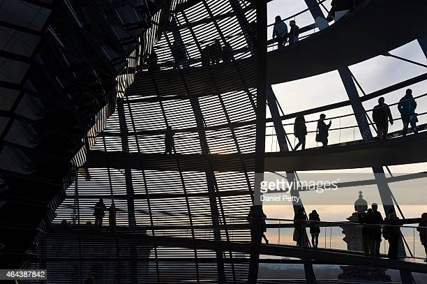 People walk along the dome of the Reichstag Building Germany's parliament on November 17 in Berlin Germany