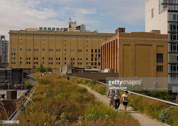 People walk along the High Line near 20th Street on September 10 2011 in New York City The High Line is a onemile long New York City Park on the...