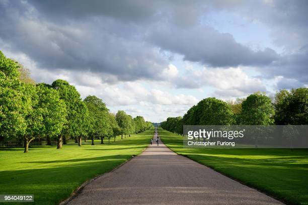 People walk along The Long Walk at Windsor Castle as it prepares for the weddiing of Prince Harry and his fiance US actress Meghan Markle May 2 2018...