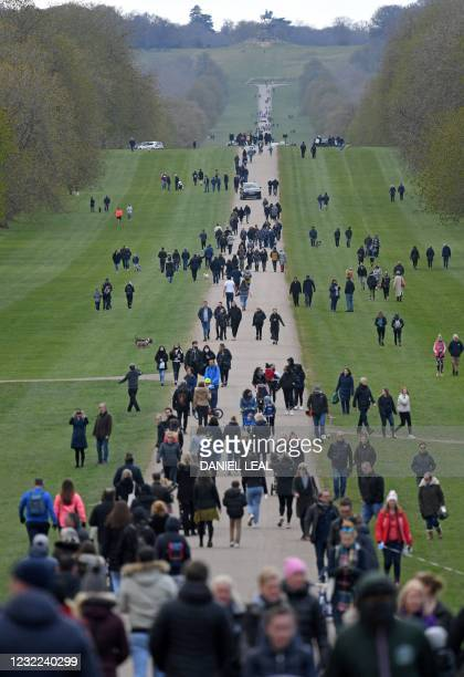 People walk along The Long Walk in Windsor Great Park, leading to Windsor Castle in Windsor, west of London, on April 11 two days after the death of...