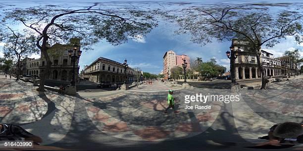 People walk along the Paseo del Prado as Cuba prepares for the visit of U.S. President Barack Obama on March 18, 2016 in Havana, Cuba. Mr. Obama's...