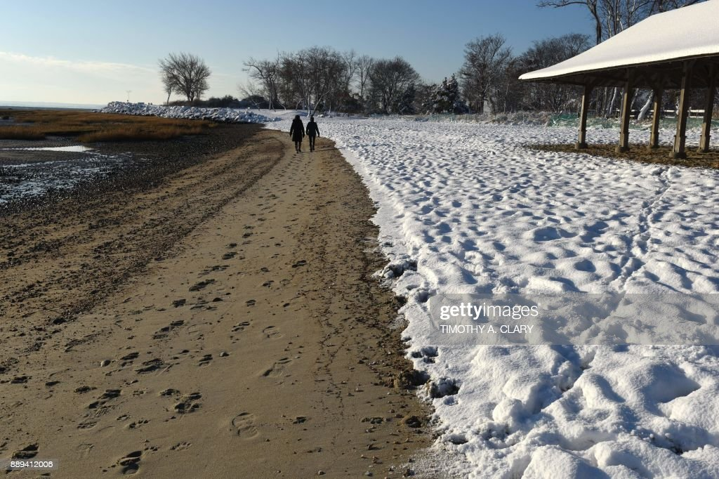 People Walk Along The Snow Covered Beach At Tod S Point Greenwich Park In Connecticut December 10 2017 Morning After