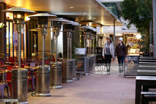 People walk along the Southbank precinct on June 29, 2021 in Brisbane, Australia. Queensland Premier Annastacia Palaszczuk has announced a three-day...