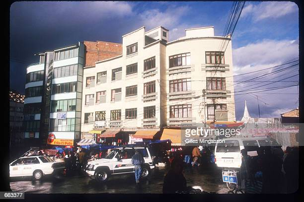 People walk along the street June 15 1999 in La Paz Bolivia The population of Bolivia is composed of Native Americans mainly following ancestral...
