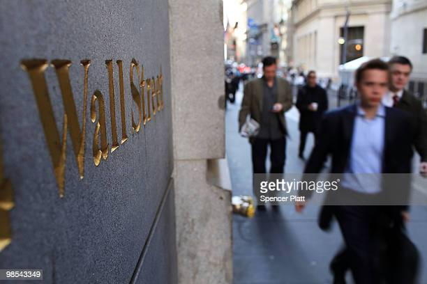 People walk along Wall Street in the financial district on April 19, 2010 in New York City. Increased scrutiny of numerous Wall Street financial...