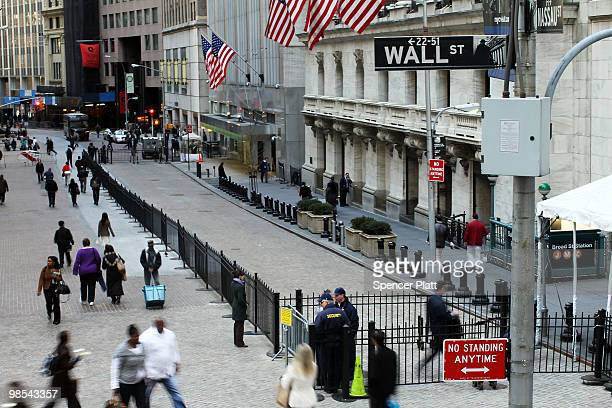 People walk along Wall Street in the financial district on April 19 2010 in New York City Increased scrutiny of numerous Wall Street financial...
