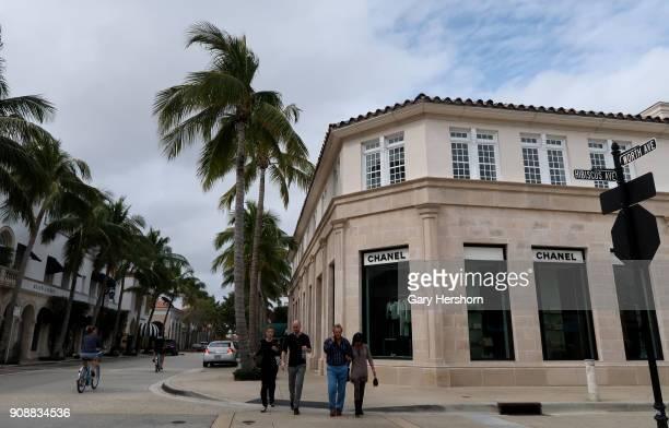 People walk along Worth Avenue on January 21 2018 in Palm Beach Florida