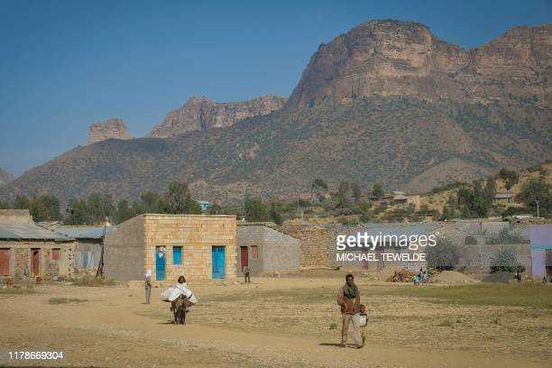People walk alongside a dirt road where common cultural practises are complimented by crossborder trade between communities from both Ethiopia and...