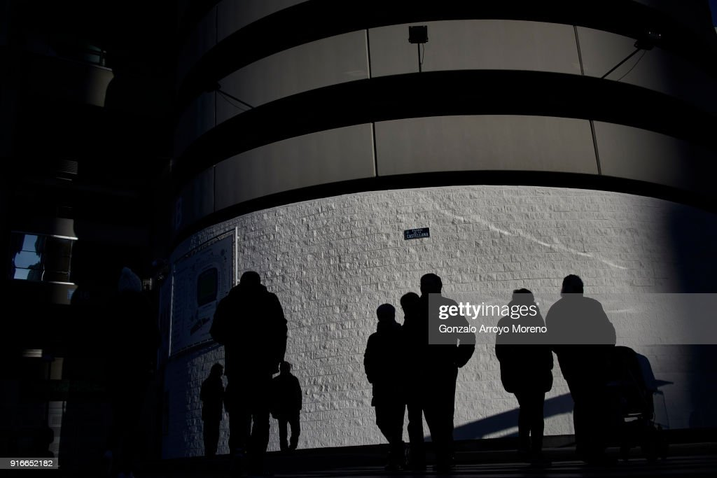 People walk alongside Estadio Santiago Bernabeu outdoors before the La Liga match between Real Madrid CF and Real Sociedad de Futbol on February 10, 2018 in Madrid, Spain.