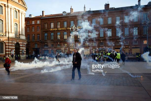 People walk amid tear gas Act XIII dubbed 'Civil disobediencequot' of the Yellow Vest movement begun peacefully but the protest turned to riot...