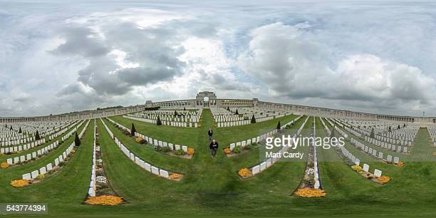 People walk among headstones in the Pozieres British Cemetery on May 18 2016 near Albert France This year will see the 100th anniversary of the start...