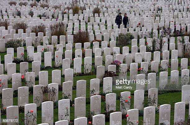 People walk among headstones in the Tyne Cot Cemetery the largest Commonwealth war grave cemetery in the world on November 5 2008 near Ypres Belguim...