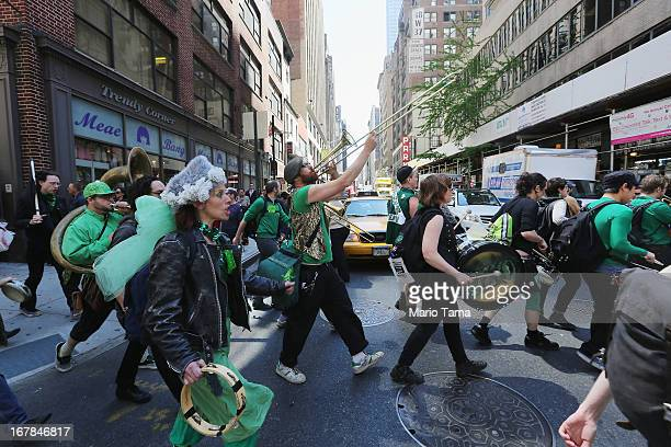 People walk and perform during a march for immigrant worker rights as part of May Day rallies on May 1 2013 in New York City Rallies and marches are...