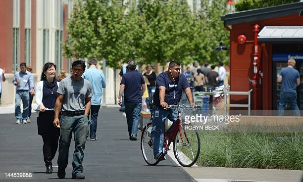 People walk and ride bicycles at the Facebook main campus in Menlo Park California May 15 2012 Facebook the world's most popular internet social...