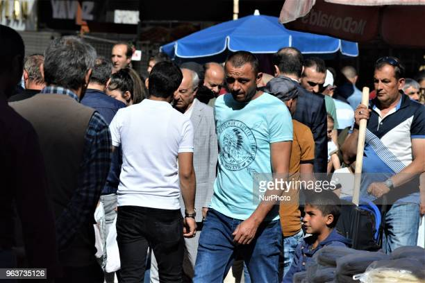 People walk around a bazaar during the Muslim holy fasting month of Ramadan in the historic Ulus district of Ankara Turkey on May 27 2018
