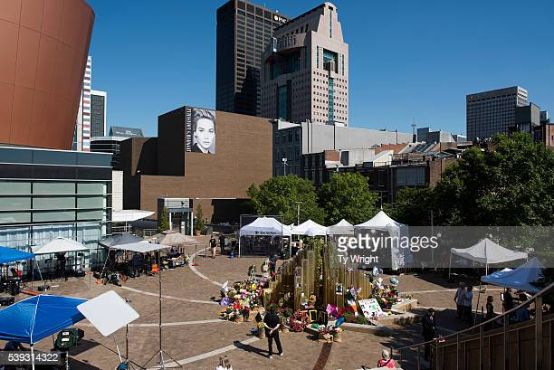 People walk around a memorial decorated with tributes to Muhammad Ali at the Muhammad Ali Center on June 10 2016 in Louisville Kentucky After the...