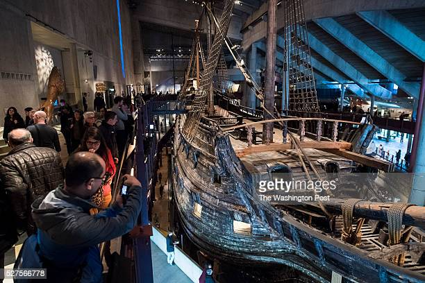 People walk around and look in a museum for the well-preserved, 17th-century warship, Vasa, that sank on her maiden voyage in 1628 in Stockholm,...