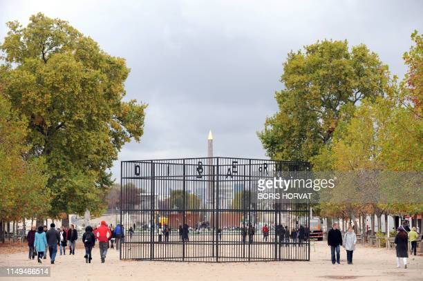 """People walk around """"Pistoletto"""" a work by Spazio Libero de Michelangelo on October 16, 2008 at the Tuileries garden in Paris during the preparations..."""